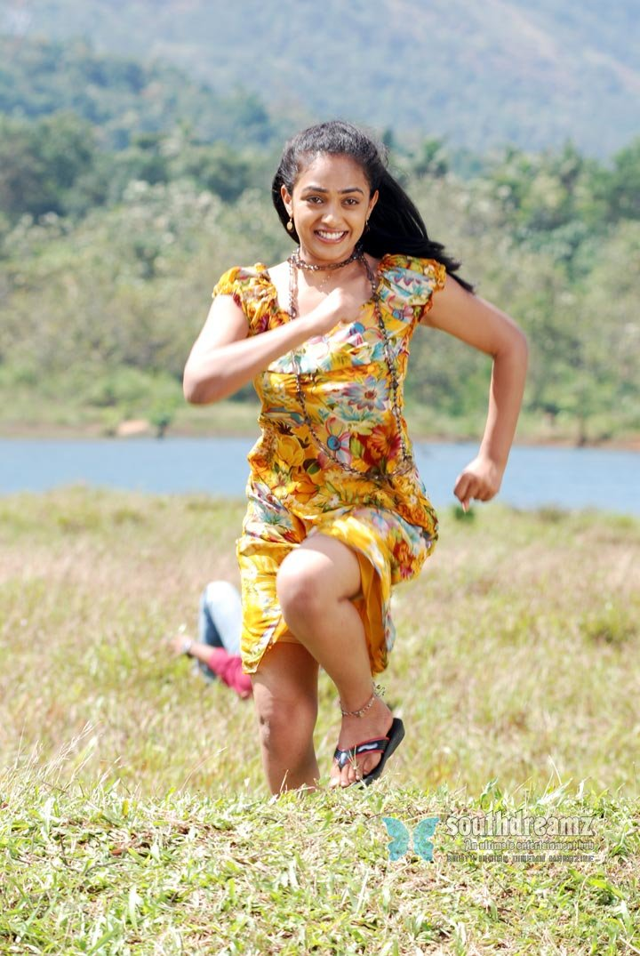 Cute actress nithya menon hot stylish photo shoot 1
